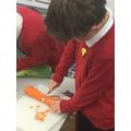 Peeling the carrots.