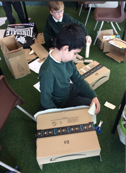 Here is a child working hard on their castle.
