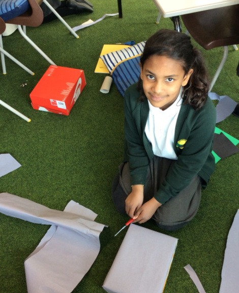 This image shows a student working hard on her castle design.