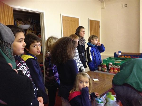 Listening to a talk from the Food Bank Staff