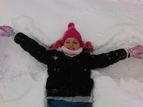 Emilie Mardell making a snow angel - 5F