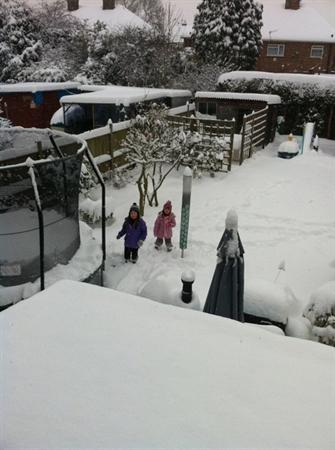 Lauren Dowd & her sister playing in back garden