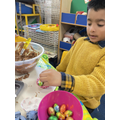 Usmaan is making chocolate nest with shreddies and eggs.