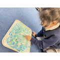 Creating marbled patterns using shaving foam and food dye