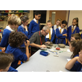 Andrew Hill showing clay techniques to Y6.