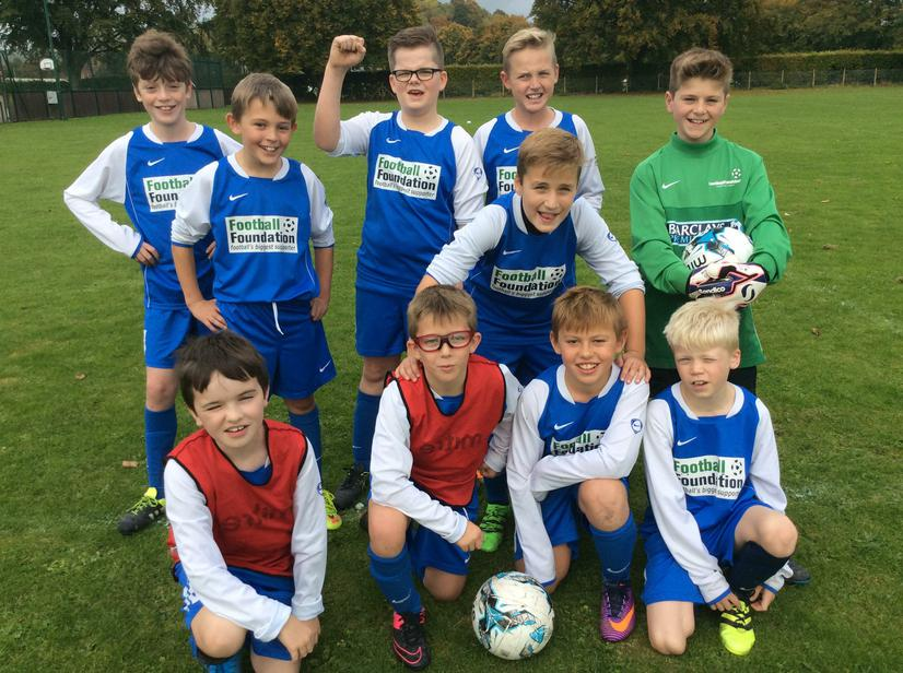 The Year 5/6 football team win in the cup!