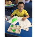 Developing our fine motor skills and making decorations for our reading room