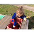 Playing in the mud kitchen