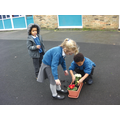 Planting window boxes during STEM week.