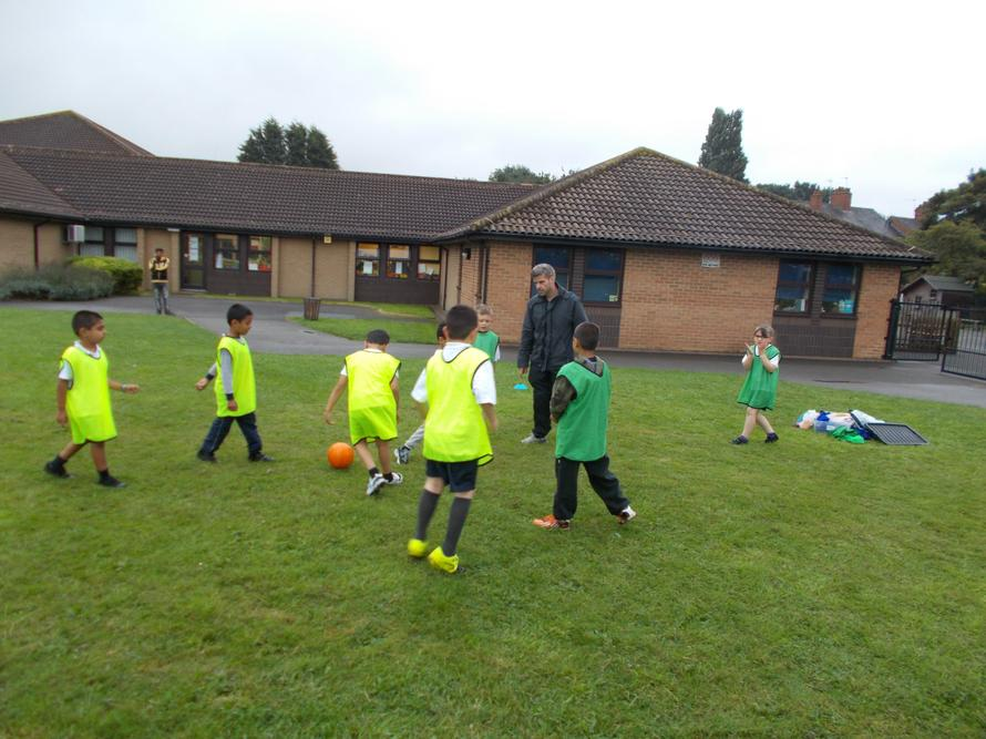 Our afterschool football club braved the rain.