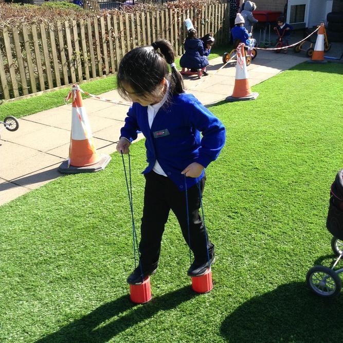 Stilt walking is quite a skill!