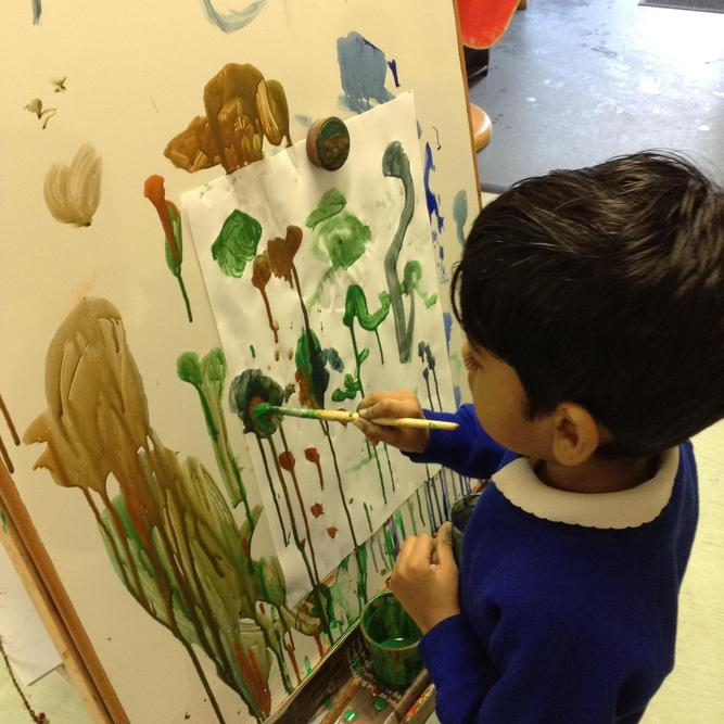 Mixing colours and making marks.
