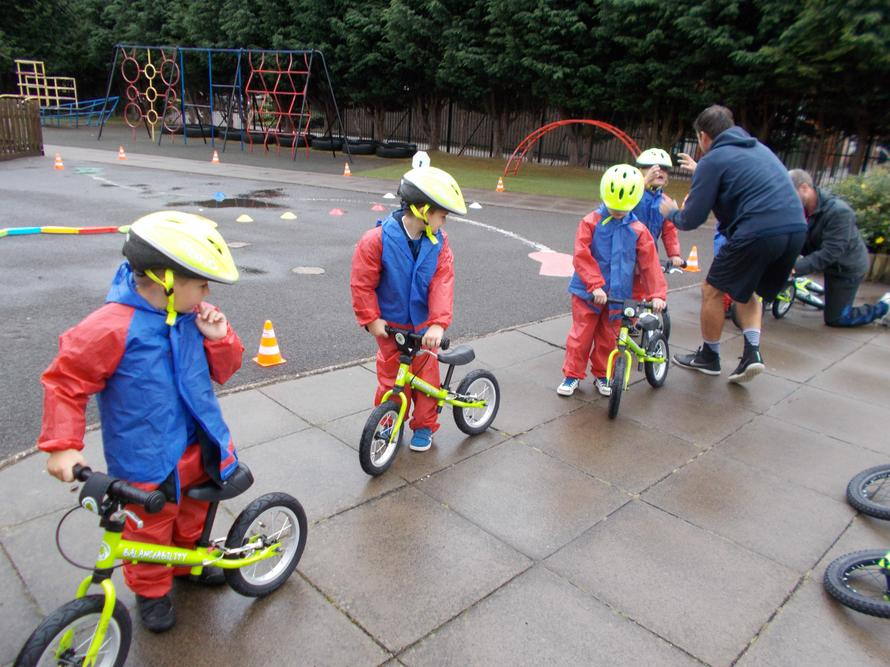 Never mind the rain our children rode their bikes.