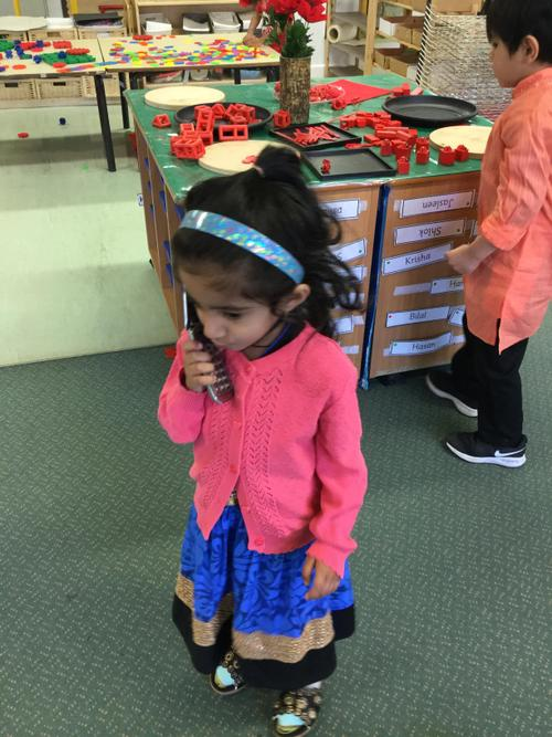 Having an important phone call during our Diwali party.