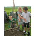 Year 3 help to make a wigwam for yr6
