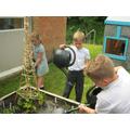 Year3 watering their veg plot