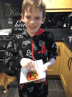 Jacob has been growing strawberries!