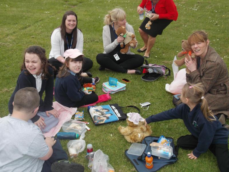The nurture children enjoying their picnic!