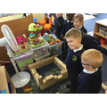 The children built a house using blocks.