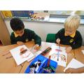 Ruyan and Jamie making crayon and paint menorahs