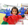 We got very messy making hand print menorahs!