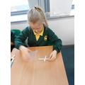 Charlie making her cross