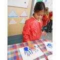 Brinda making a handprint menorah!