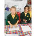 Charlie and Eimaan making a handprint menorah!