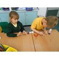 Isla and Matthew making their crosses!