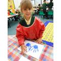 Isla making a handprint menorah!