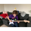Isaac's guitar practise being overseen by his pet, Alex!