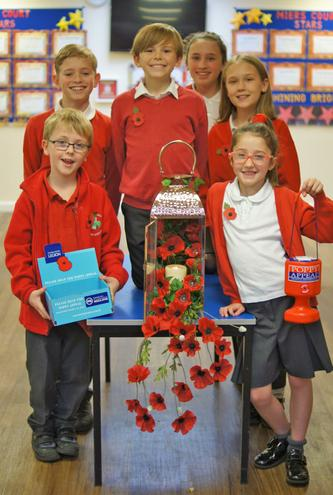 School council memebrs preparing to sell poppies around the school
