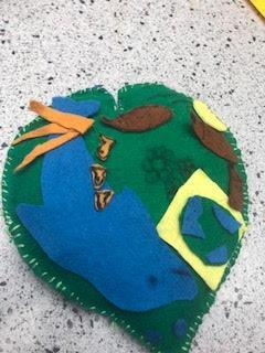 Ellie's Earth Heart with dolphins and hedgehogs