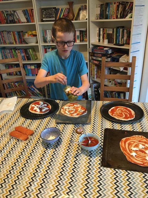 Daniel making pizza
