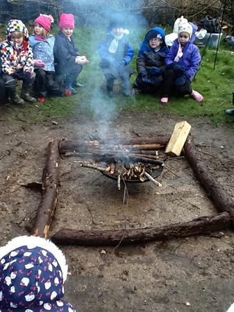 Warming ourselves around the fire circle.