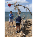 Kit & Joe  decorate epic beach sculpture.