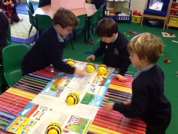 We are giving Bee Bots instructions.