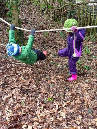 We love swinging on the rope bridge.