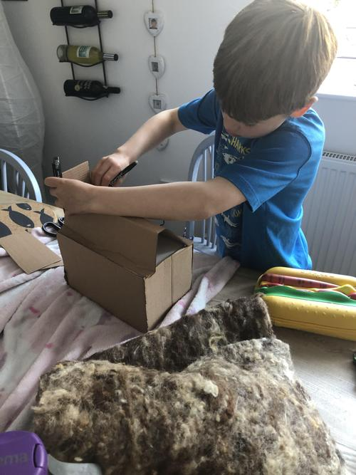 Hamish making an Anglo Saxon house.
