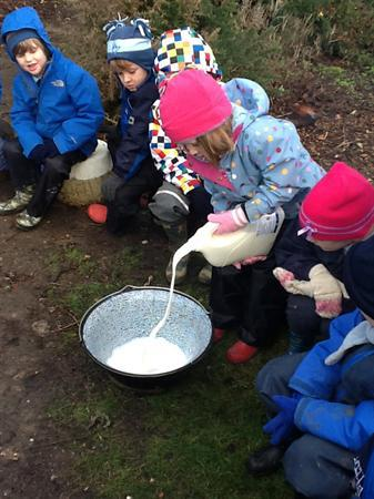 Pouring milk to make our own hot chocolate.
