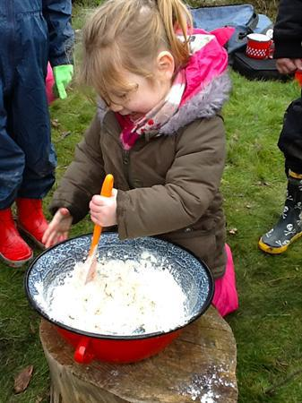 Stirring the bread mixture. It's hard work!