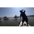 Charlie paddling the ocean blue