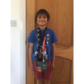 Isaac with his Dad's Concert and Festival Lanyards