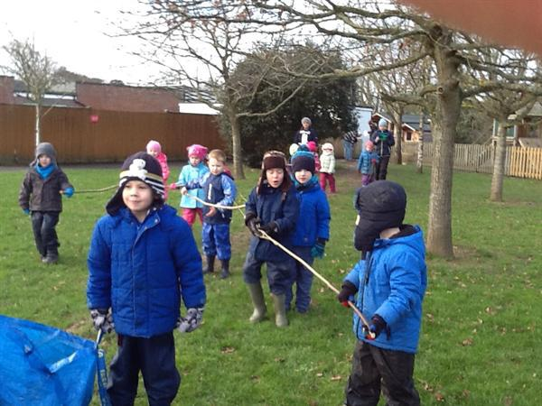 Carrying large sticks for our whittling.