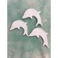 Rafe's clay dolphins ready to glaze.