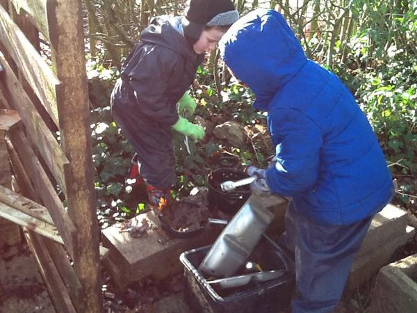 We are enjoying the mud kitchen.