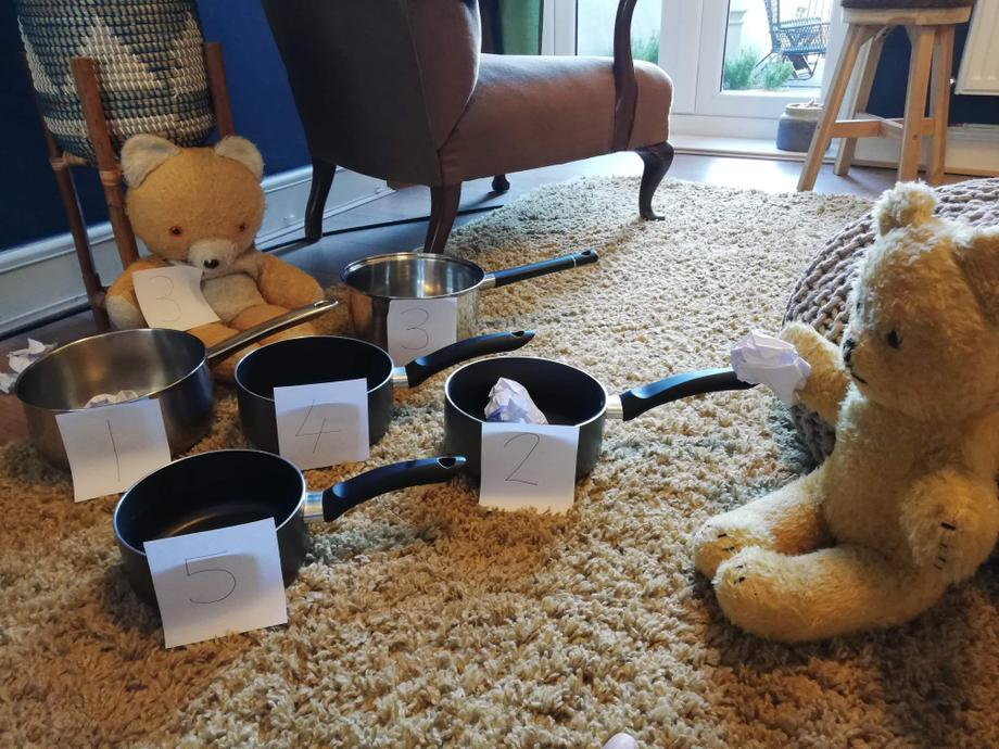 Big Ted asked Little Ted to throw the paper ball into number 2 saucepan.
