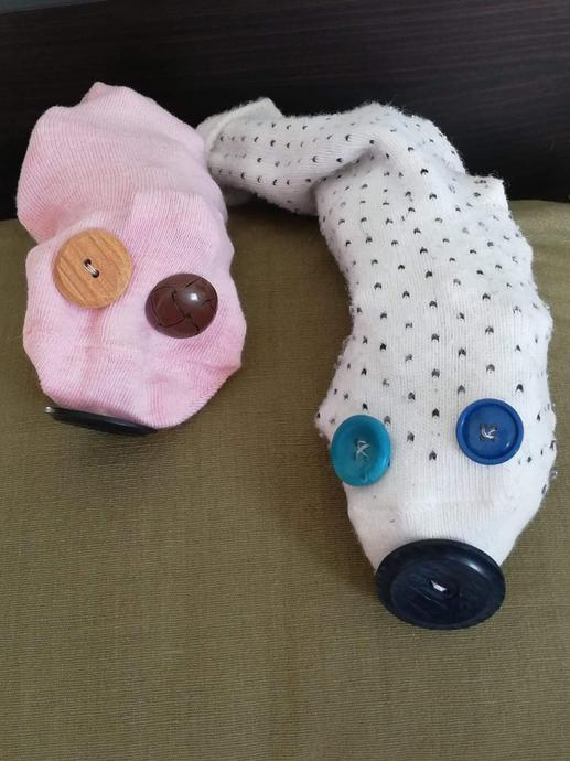 How would you make a puppet? The Teddies have sewn buttons onto socks.