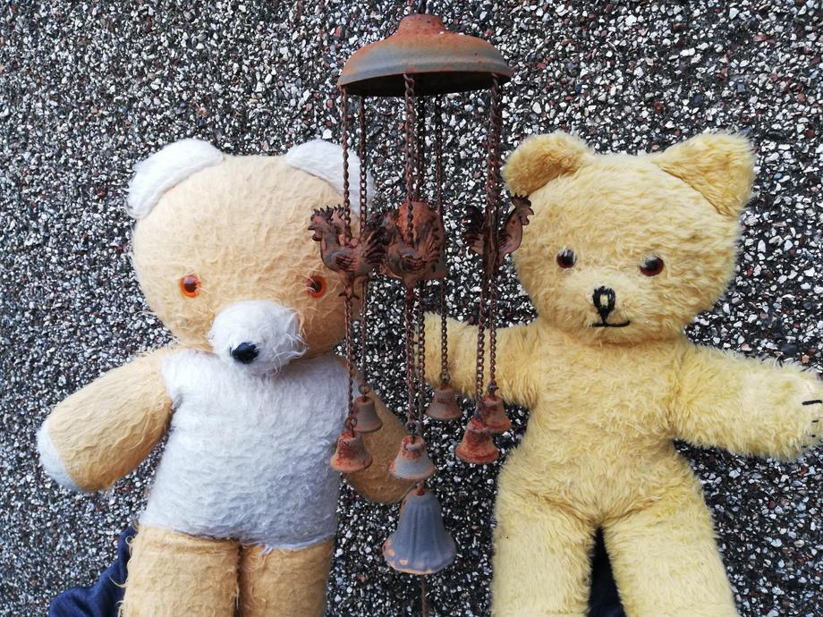 The Teddies listened to the music of the wind chimes when the wind blew.
