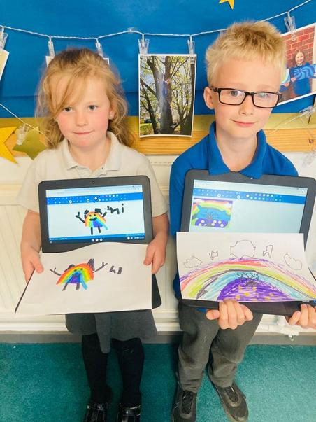 Year Three comparing their computer-generated and hand-drawn pictures